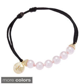 Sterling Essentials Gold Plated Silver and Pink Pearl Initial Friendship Bracelet|https://ak1.ostkcdn.com/images/products/8398590/Sterling-Essentials-Gold-Plated-Silver-and-Pink-Pearl-Initial-Friendship-Bracelet-P15699924.jpg?impolicy=medium