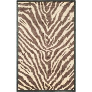 Safavieh Hand-knotted Tibetan Animal Print Black/ Ivory Wool Rug (5' x 7'6)