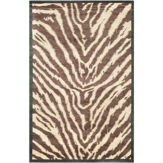 Safavieh Hand-knotted Tibetan Animal Print Black/ Ivory Wool Rug (8' x 10')