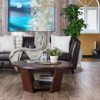 Clay Alder Home Four Bears Round Vintage Walnut Coffee Table