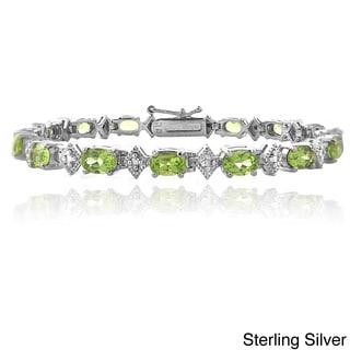 Link to Glitzy Rocks Sterling Silver Peridot and Diamond-accent Bracelet (I-J, I2-I3) Similar Items in Bracelets
