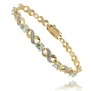 Dolce Giavonna 14k Gold Overlay Blue Topaz and Diamond 'XOXO' Bracelet