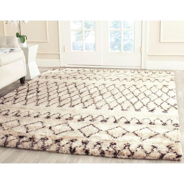 Safavieh handmade casablanca moroccan flokati shag ivory for Black and white wool rug