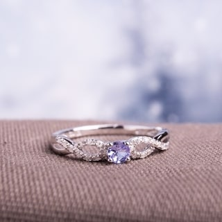 Miadora Sterling Silver Tanzanite and 1/10ct TDW Diamond Ring (H-I, I2-I3)