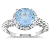 Miadora Sterling Silver Blue Topaz and 1/5ct TDW Diamond Ring (H-I, I2-I3)