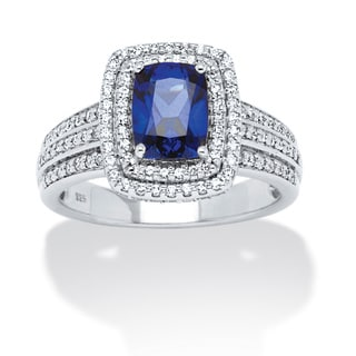 1.94 TCW Emerald-Cut Midnight Blue Sapphire and Round Cubic Zirconia Ring in Platinum over