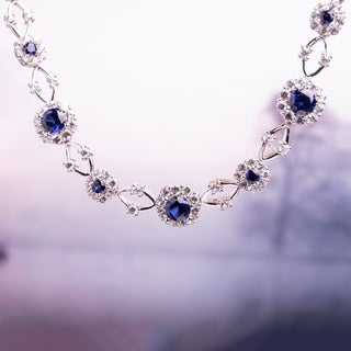 Miadora Sterling Silver Created Blue and White Sapphire Flower Necklace