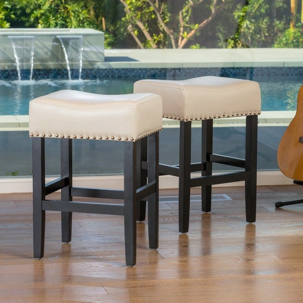 Lisette 26-inch Backless Ivory Leather Counter Stool (Set of 2) by Christopher Knight Home. Opens flyout.