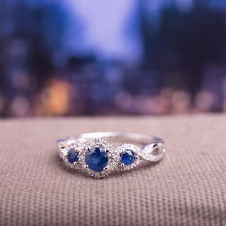 Miadora Signature Collection 10k White Gold Sapphire and 1/8ct TDW Diamond 3-stone Infinity Engagement Ring|https://ak1.ostkcdn.com/images/products/8746553/Miadora-10k-White-Gold-Sapphire-and-1-8ct-TDW-Diamond-Engagement-Ring-H-I-I2-I3-P15991864.jpg?impolicy=medium