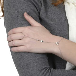 Journee Collection Sterling Silver Cubic Zirconia Heart Ring to Wrist Bracelet https://ak1.ostkcdn.com/images/products/8815130/Tressa-Sterling-Silver-Cubic-Zirconia-Heart-Ring-to-Wrist-Bracelet-P16049577.jpg?impolicy=medium
