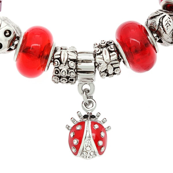 La Preciosa Silvertone Crystal and Glass Ladybug Charm Bracelet