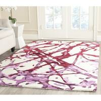 Isaac Mizrahi by Safavieh Handmade Plum Blossom Wool Rug - 4' x 6'