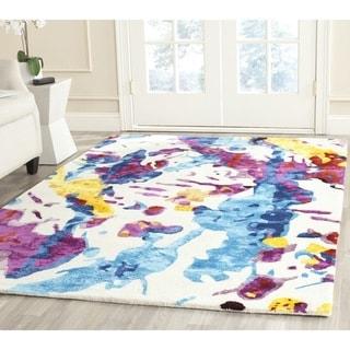 Isaac Mizrahi by Safavieh Handmade Peach Splatter Wool Rug (4' x 6')