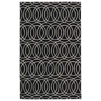 Hand-tufted Cosmopolitan Circles Black/ Ivory Wool Rug - 5' x 7'9