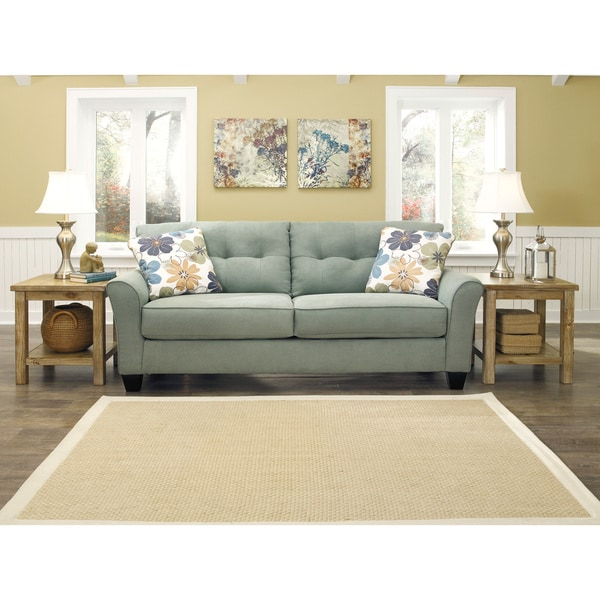 signature design by ashley kylee lagoon sofa and accent pillows