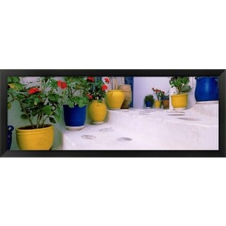 'Potted plants on steps, Mykonos, Greece' Framed Panoramic Photo