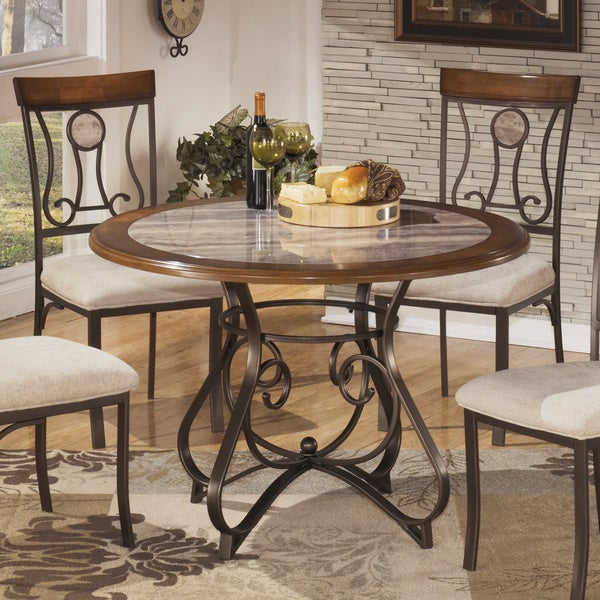 signature design by ashley hopstand round dining table