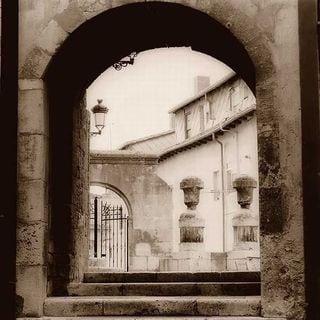 Alan Blaustein 'Courtyard in Burgos' Canvas Art