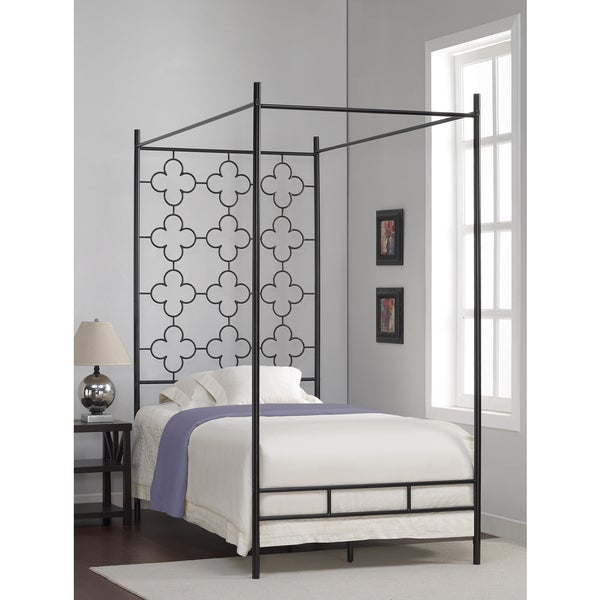 The Curated Nomad Quatrefoil Twin Canopy Bed