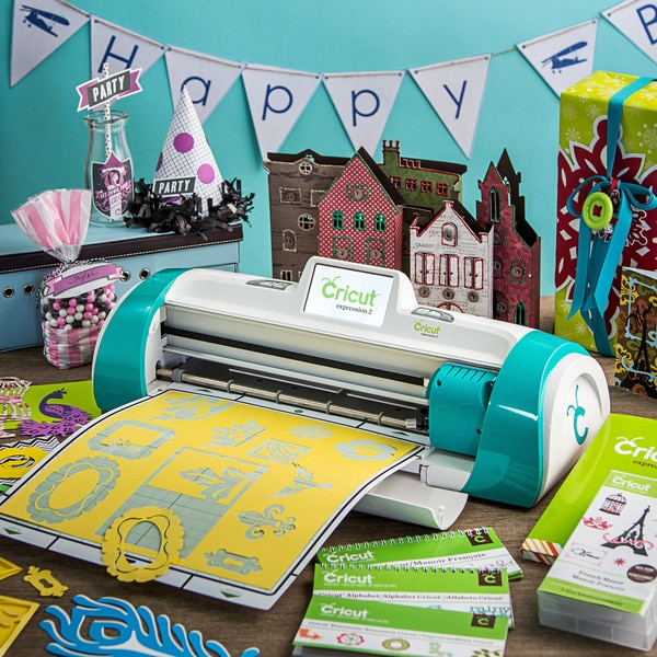 Cricut expression 2 teal die cut machine with 2 preloaded for Craft die cutting machine