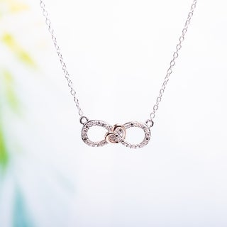 Link to Miadora Sterling Silver 1/10 ct. TDW Diamond Heart Infinity Necklace Similar Items in Bracelets