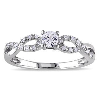 Miadora 10k White Gold Created White Sapphire and 1/10ct TDW Diamond Crossover Engagement Ring (H-I, I2-I3)
