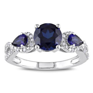 Miadora Sterling Silver Created Sapphire and 1/6ct TDW Diamond 3-Stone Crossover Ring
