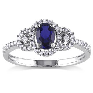 Miadora 10k White Gold Created Blue Sapphire and 1/6ct TDW Diamond Ring (H-I, I2-I3)