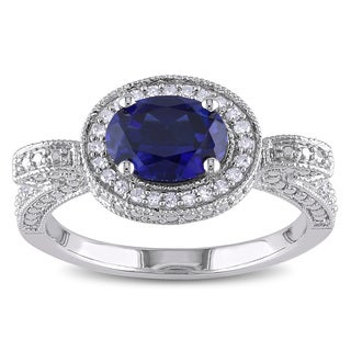 Miadora Sterling Silver Created Blue Sapphire and 1/6ct TDW Diamond Ring (H-I, I2-I3)