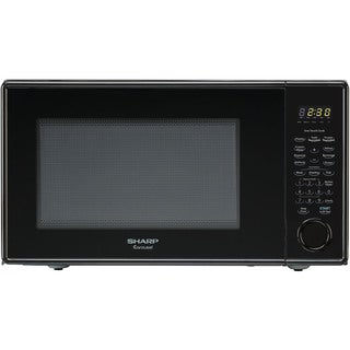 Sharp R309 Series Mid-Size 1.1 Cu. Ft. 1000W Microwave Oven in Black