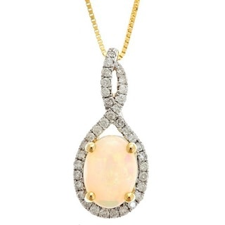 Anika and August 14k Yellow Gold Oval-cut Australian Opal and 1/5ct TDW Diamond Pendant (G-H, I1-I2)