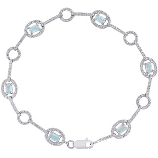 Dolce Giavonna Sterling Silver Blue Topaz and Diamond Accent Circle Design Bracelet
