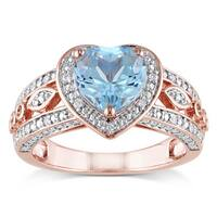 Miadora Rose Goldplated Silver Blue Topaz and 1/10ct TDW Diamond Ring (H-I, I2-I3)