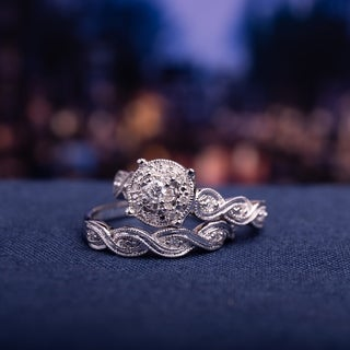 Miadora Sterling Silver 1/5ct TDW Diamond Infinity Filigree Vintage Halo Bridal Ring Set