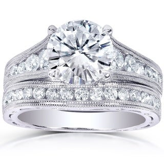 Annello by Kobelli 14k White Gold 2 4/5ct TGW Round Moissanite (HI) and Channel-set Diamond Milgrain Edged Bridal Rings Set|https://ak1.ostkcdn.com/images/products/9363577/P16555568.jpg?_ostk_perf_=percv&impolicy=medium