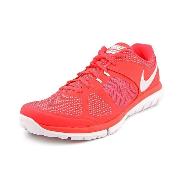 5aa3f97bb68af Shop Nike Women s  Flex 2014 RN Premium  Man-Made Athletic Shoe ...