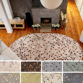 Hand-tufted Floral Oval Wool Area Rug (8' x 10')