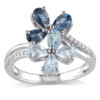 Miadora Sterling Silver Blue Topaz and 1/10ct TDW Diamond Flower Ring (H-I, I2-I3)