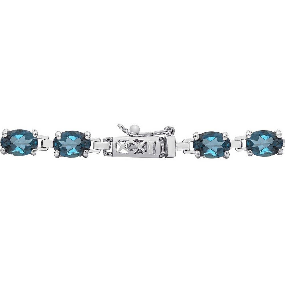 Shop Dolce Giavonna Sterling Silver London Blue Topaz Tennis Style Bracelet in Red Bow Gift Box - Overstock - 9435382