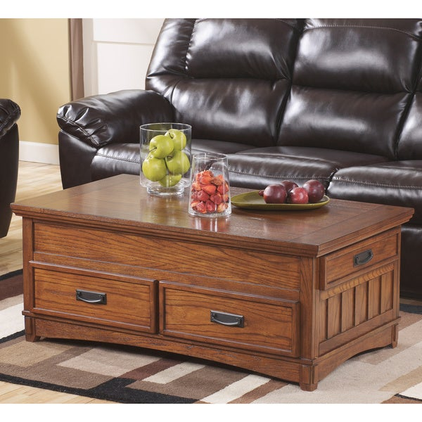 Porter Round Coffee Table: Signature Designs By Ashley Cross Island Medium Brown Lift