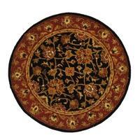 Safavieh Handmade Heritage Traditional Kerman Black/ Red Wool Rug - 5' Round
