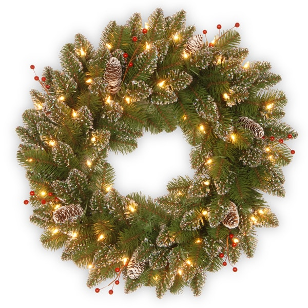24-inch Glittery Mountain Spruce Wreath with White Edged Cones, Red Berries and Lights. Opens flyout.