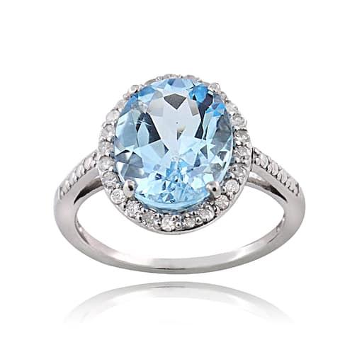 Glitzy Rocks Sterling Silver 1/4ct TDW Diamond Blue Topaz Cocktail Ring