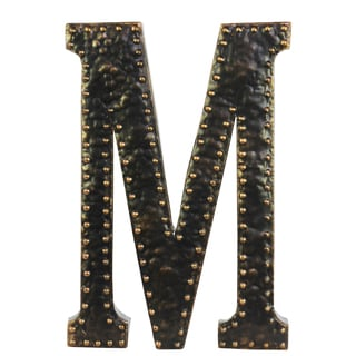 black metal letter m wall decor