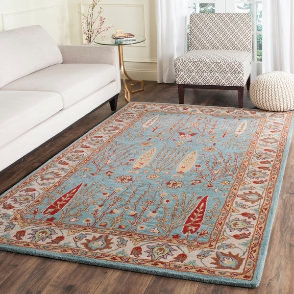 Safavieh Handmade Heritage Timeless Traditional Blue/ Ivory Wool Rug - 7'6 x 9'6