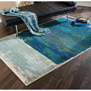 Faded Abstract Blue/ Purple Area Rug (4' x 5'9)