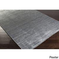 Hand-woven Dan Solid Viscose Area Rug