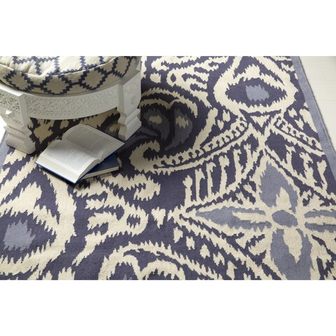 Hand-woven Cailyn Ikat Reversible Area Rug