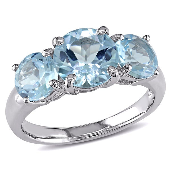 Miadora Sterling Silver Blue Topaz Three-Stone Ring. Opens flyout.