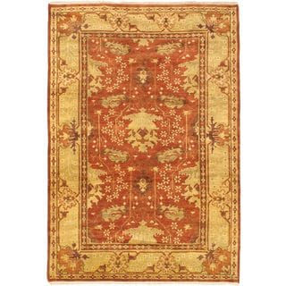 Royal Ushak Orange Open Field Hand-knotted Wool Rug (6'2 x 8'11)
